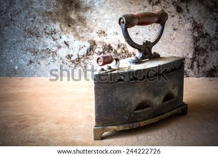 still life of antique iron - stock photo
