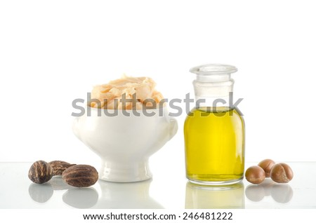 Still life of Argan oil and fruit and shea butter with nuts - stock photo