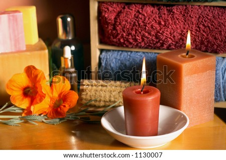 Still life of beauty treatment items with Aromatherapy Candles, Loofah and Soaps