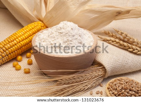 still life of bread and wheat flour, corn and oats