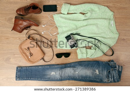 Still life of casual woman. Woman clothes and accessories on wooden background - stock photo