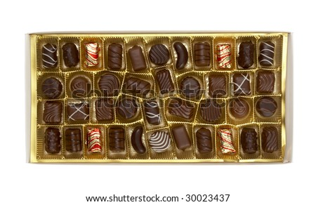 still life of chocolate praline in a box on white background with clipping path - stock photo