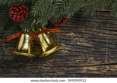 Still life of christmas ornament and tree branch on wooden board. - stock photo