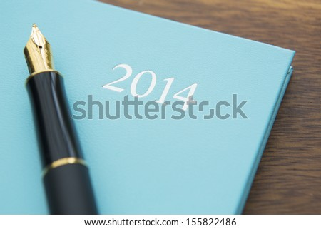 Still Life Of Diary With Fountain Pen - stock photo