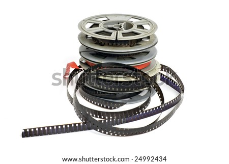 still life of dirty, old 8mm cine film and reels; isolated on white ground - stock photo
