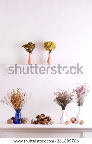 Still life of dried flowers on white wall background - stock photo