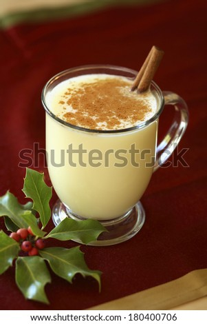 still life of eggnog and holly  - stock photo