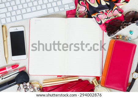 Still life of fashion woman as a frame on working desk with empty planner - stock photo