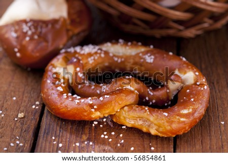 Still life of fresh pretzel with salt - stock photo