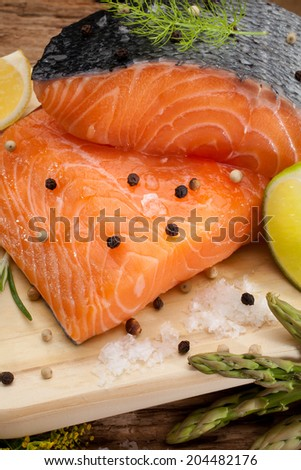 still life of fresh salmon with ingredients - stock photo