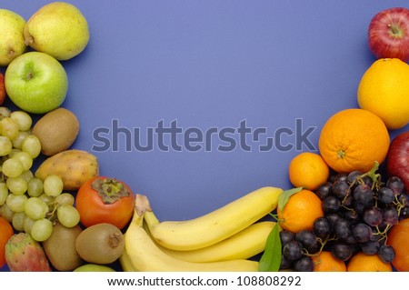 still life of fruit on a blue background - stock photo