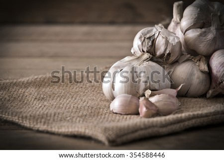 Still life of Garlic bulbs and cloves with vignette ,retro ,vintage