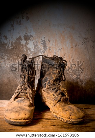 still life of old combat boots - stock photo