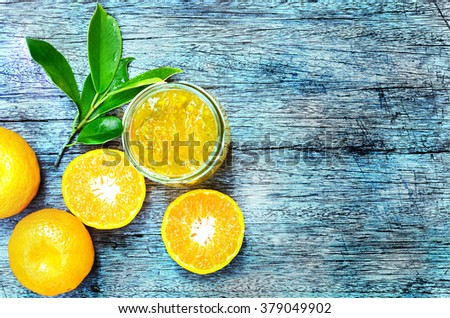 still life of Orange marmalade on wooden table with fresh fruit processed vintage style - stock photo