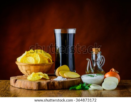 Still life of Potato-chips, cola and ingredients