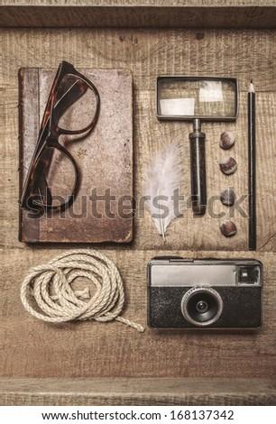 Still life of retro man in a wood background./ Overhead of essentials adventurer man.  - stock photo