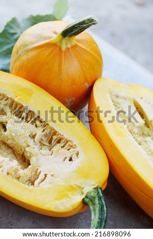 Still life of ripe organic orange pumpkins  - stock photo