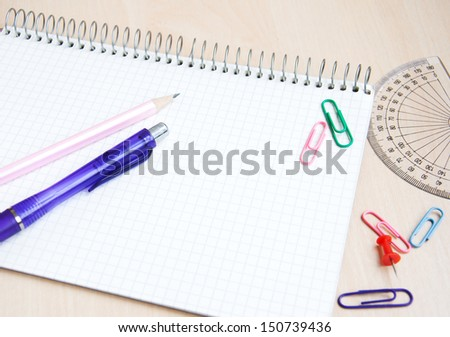 Still-life of school office supplies  with a notebook