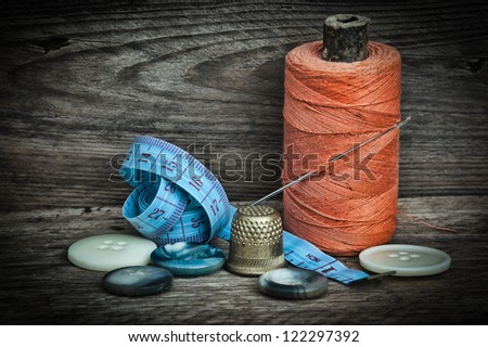 still life of spools of thread on a wooden background - stock photo