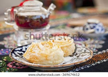 still life of tea and cakes - stock photo