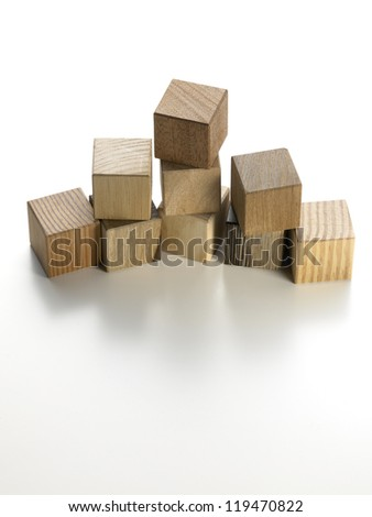 still life of various wooden cubes on a white background - stock photo