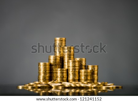 still life of very many rouleau gold  monetary or change coin, on grey background - stock photo