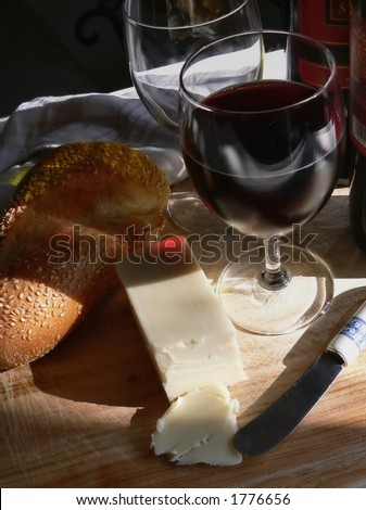 still life of wine and bread and cheese