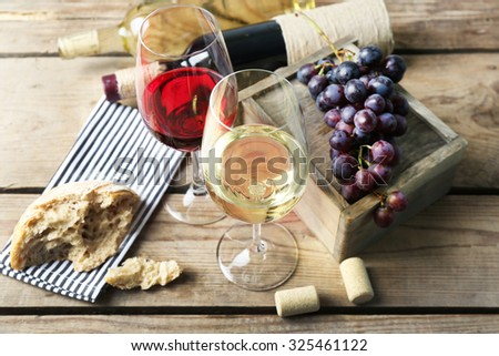 Still life of wine and bread on wooden t background - stock photo