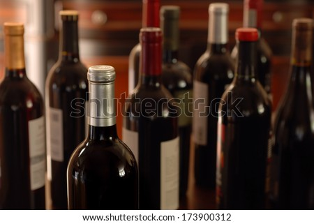 Still life of wine bottles with soft lighting and shallow dof. - stock photo