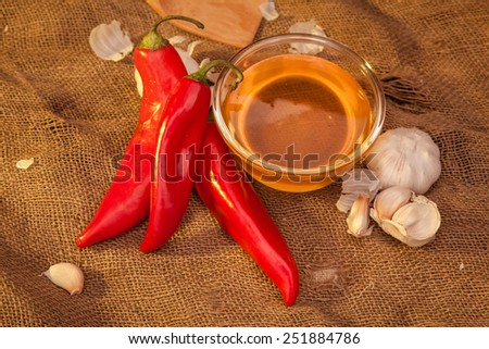 Still life on sackcloth, warm, homemade recipe. To advertise vodka, what would sober up after a hangover. Snack - ramiro sweet pepper, honey and garlic. Top view. - stock photo