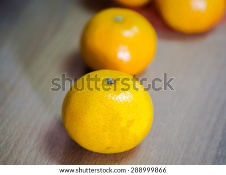 still life orange on brown floor - stock photo