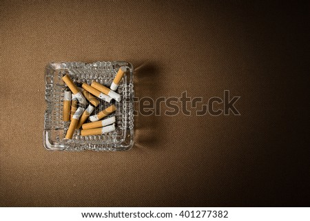 Still life photography , cigarette with ashtray on wood background. - stock photo