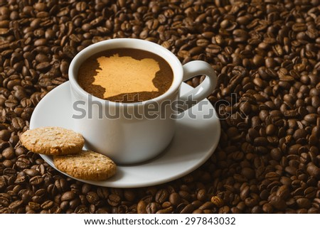Still life photography of hot coffee beverage with map of Ivory Coast