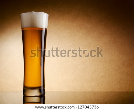 Still life photography of light beer glass - stock photo