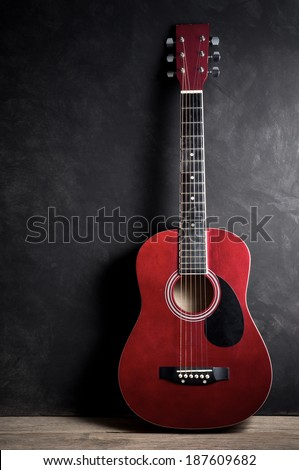 Still life photography, Old acoustic guitar on dark background - stock photo