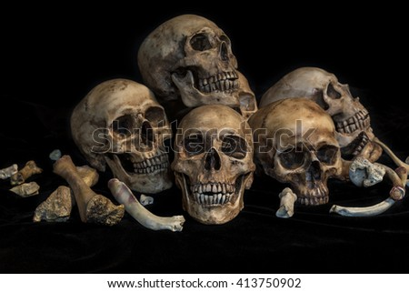 Still life photography with six of human skulls and bones in genocide concept - stock photo