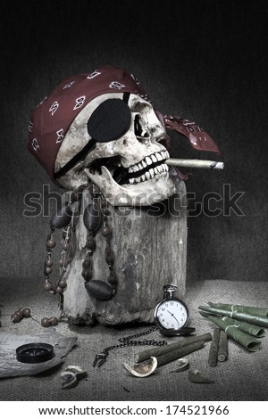 Still life, pirate skull with cigar in the mouth on the log, compass on ancient map, knife and pocket watch  - stock photo