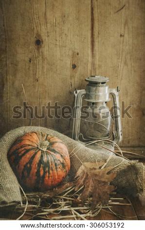 Still life. Pumpkin, lantern and autumn leaves. - stock photo