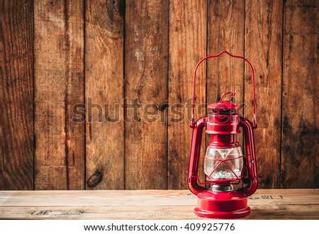 still life,Red lantern on the old wooden background.