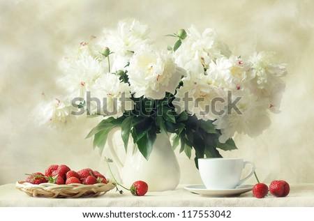 still life, splendid bouquet snow-white peony and sweet aromatic strawberry - stock photo
