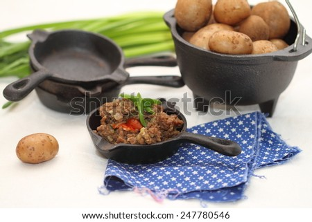 "still life: the tourist's lunch / boiled potatoes in ""uniform"" and mincemeat"