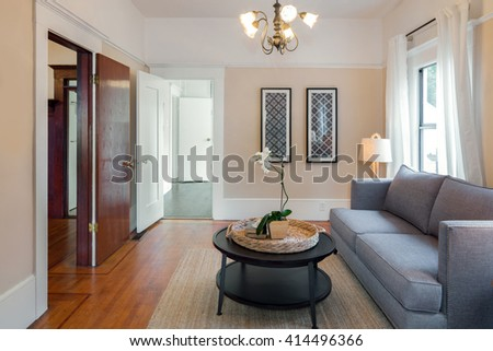 Still life view of a home lounging area with round coffee table and sofa, in an elegant house. Summer home living, empty space, inspirational lifestyle. - stock photo
