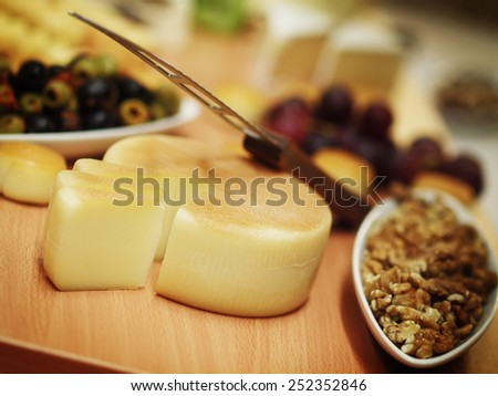 still life witch cheese, nuts and olives - stock photo