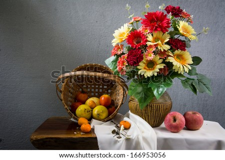Still life with a apple and a orange and passion fruit. - stock photo