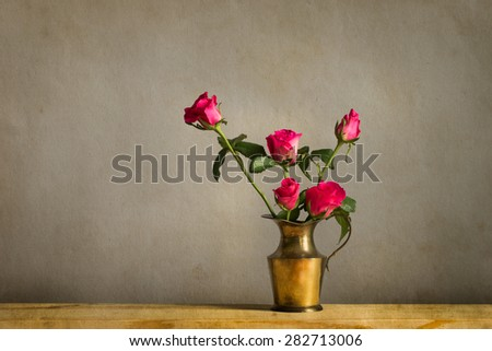 Still life with a beautiful bunch of flowers in brass pot, vintage style - stock photo