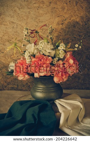 Still life with a Beautiful flowers in old vase, beautiful style. - stock photo
