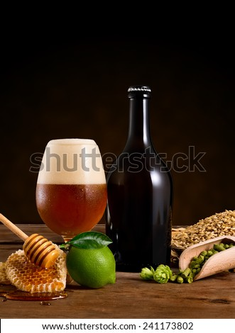 Still Life with a bottle beer and the various ingredient - stock photo