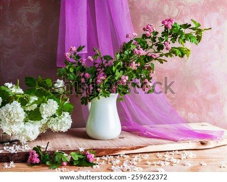 Still Life with a bouquet of hawthorn  and viburnum twigs flowers - stock photo