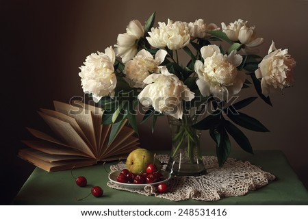 still life with a bouquet of peonies - stock photo
