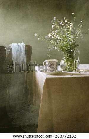 Still life with a bouquet of summer flowers and a cup of tea (retro effect) - stock photo